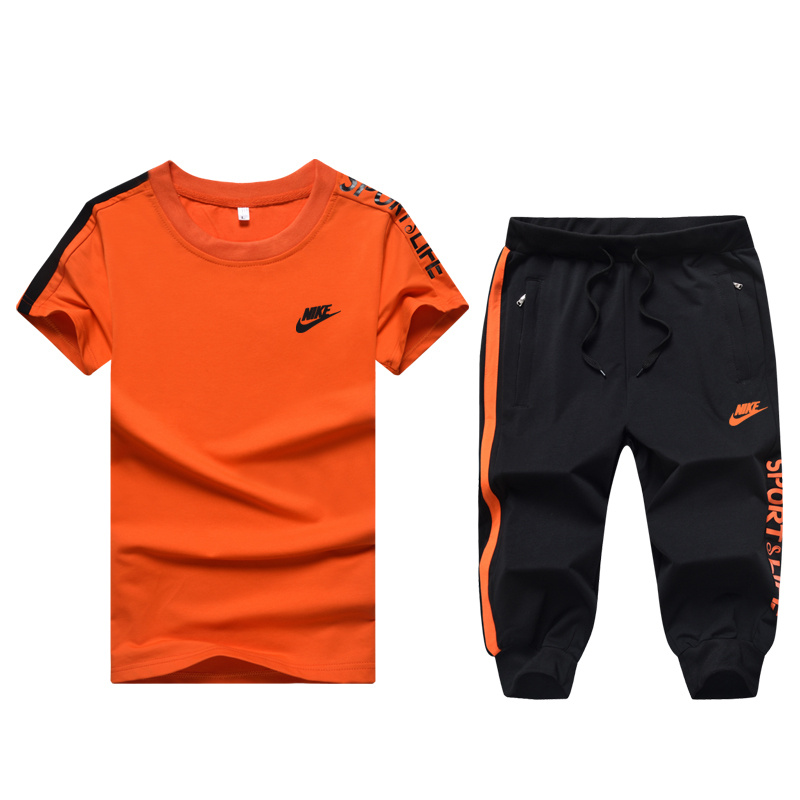 Survetement nike noir et orange - Chapka 210c6e79ed9